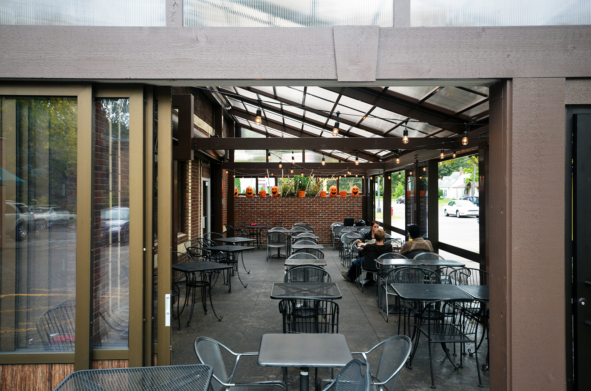 Opening restaurant patio structure