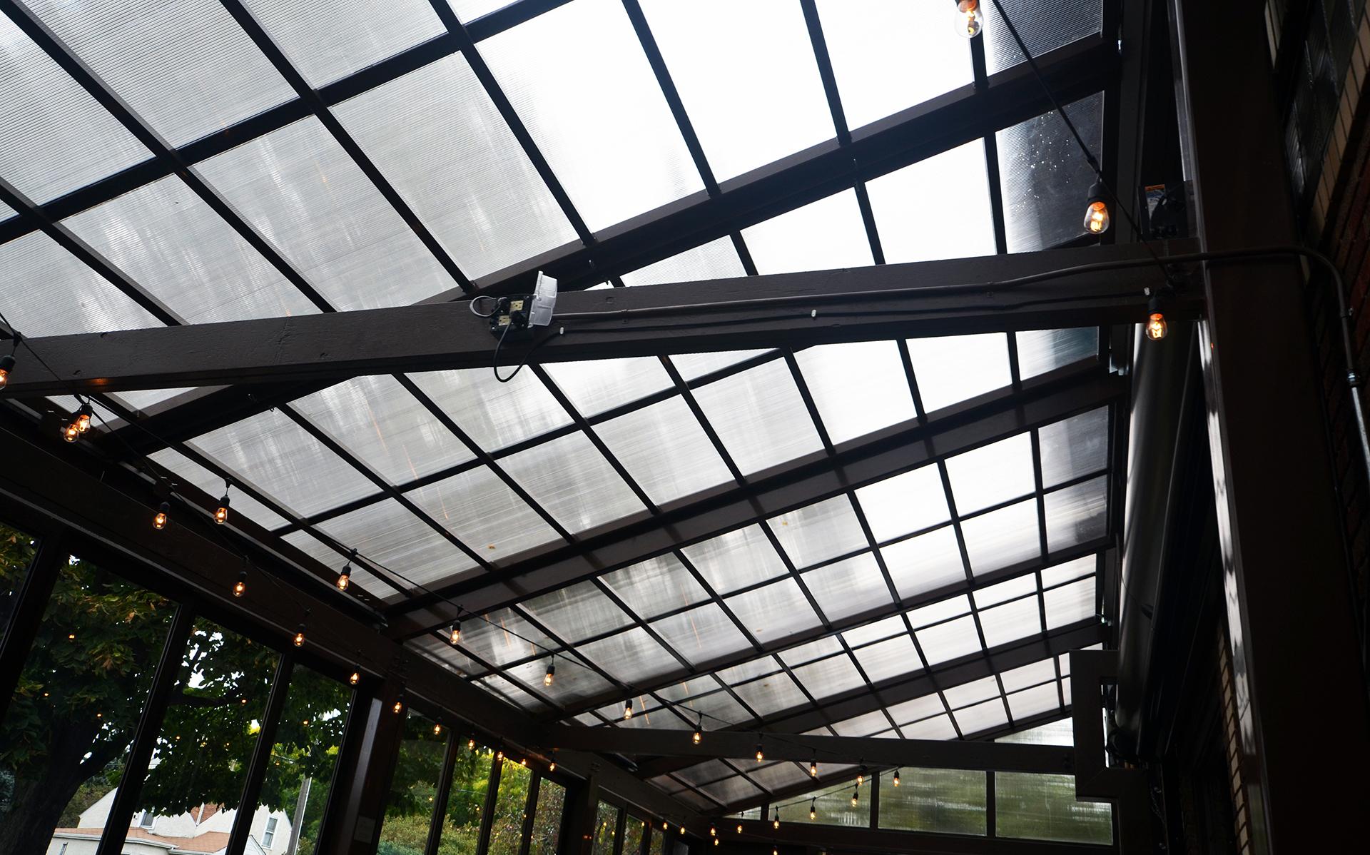 Translucent retractable roof on restaurant patio