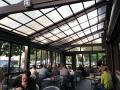 Retractable structure on restaurant patio