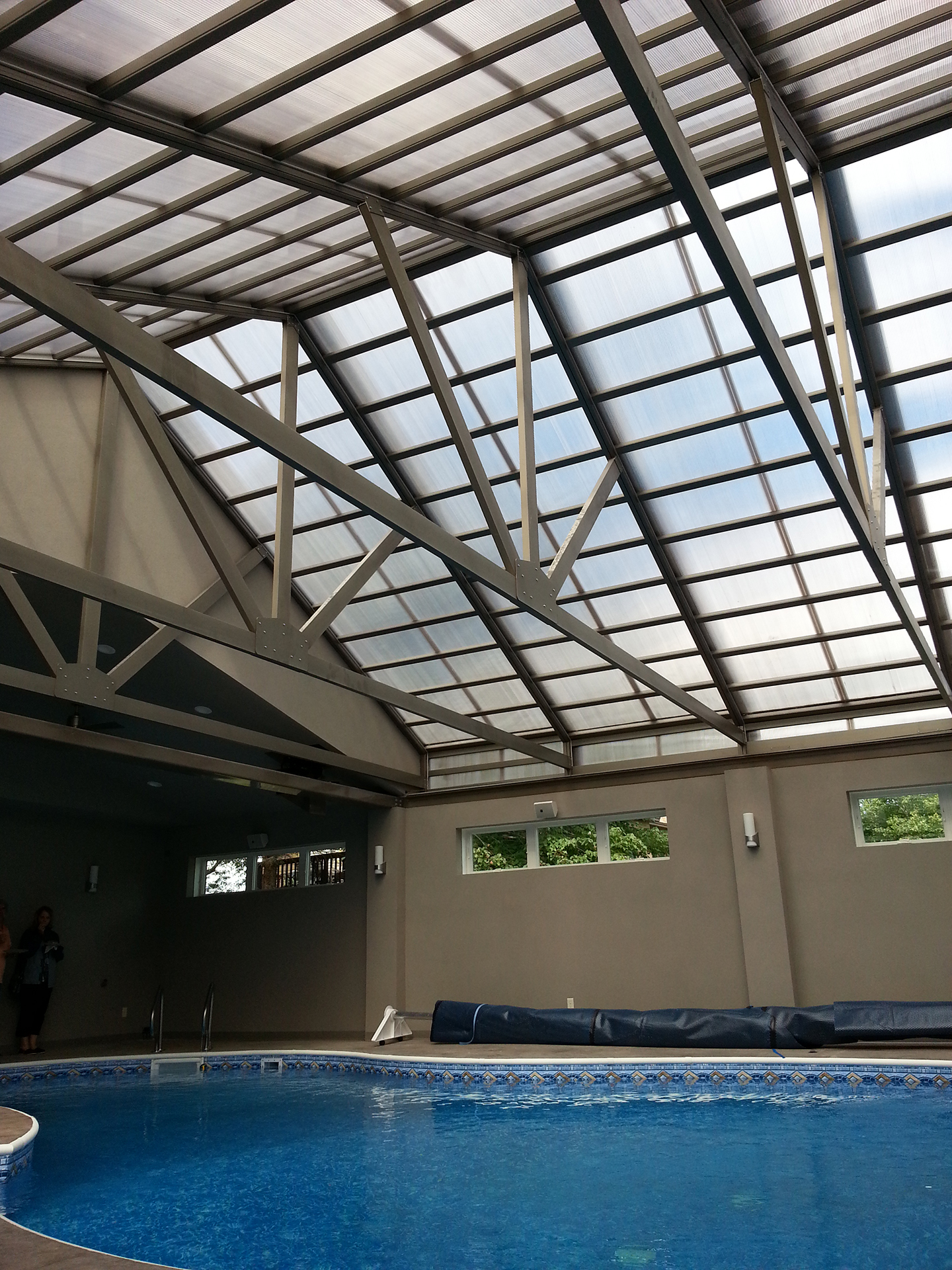 Retractable patio cover over pool