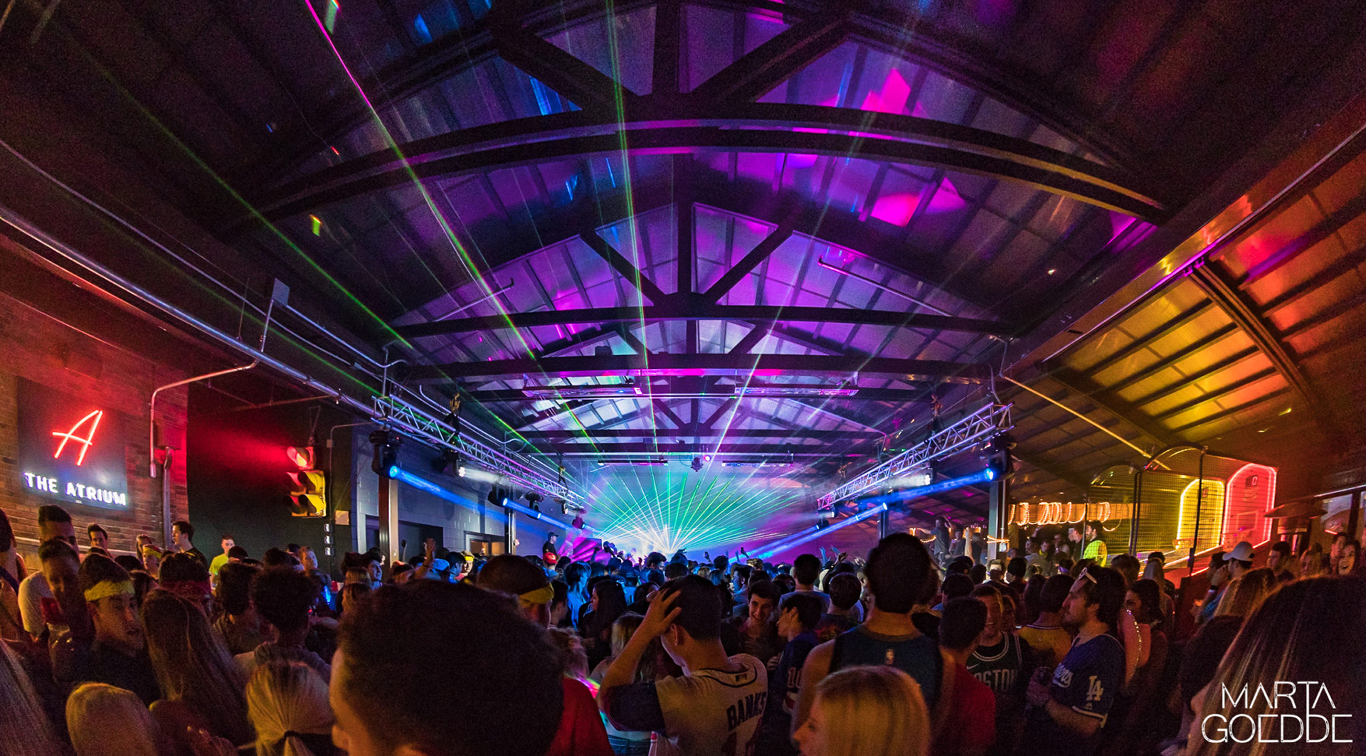 Retractable roof over event area