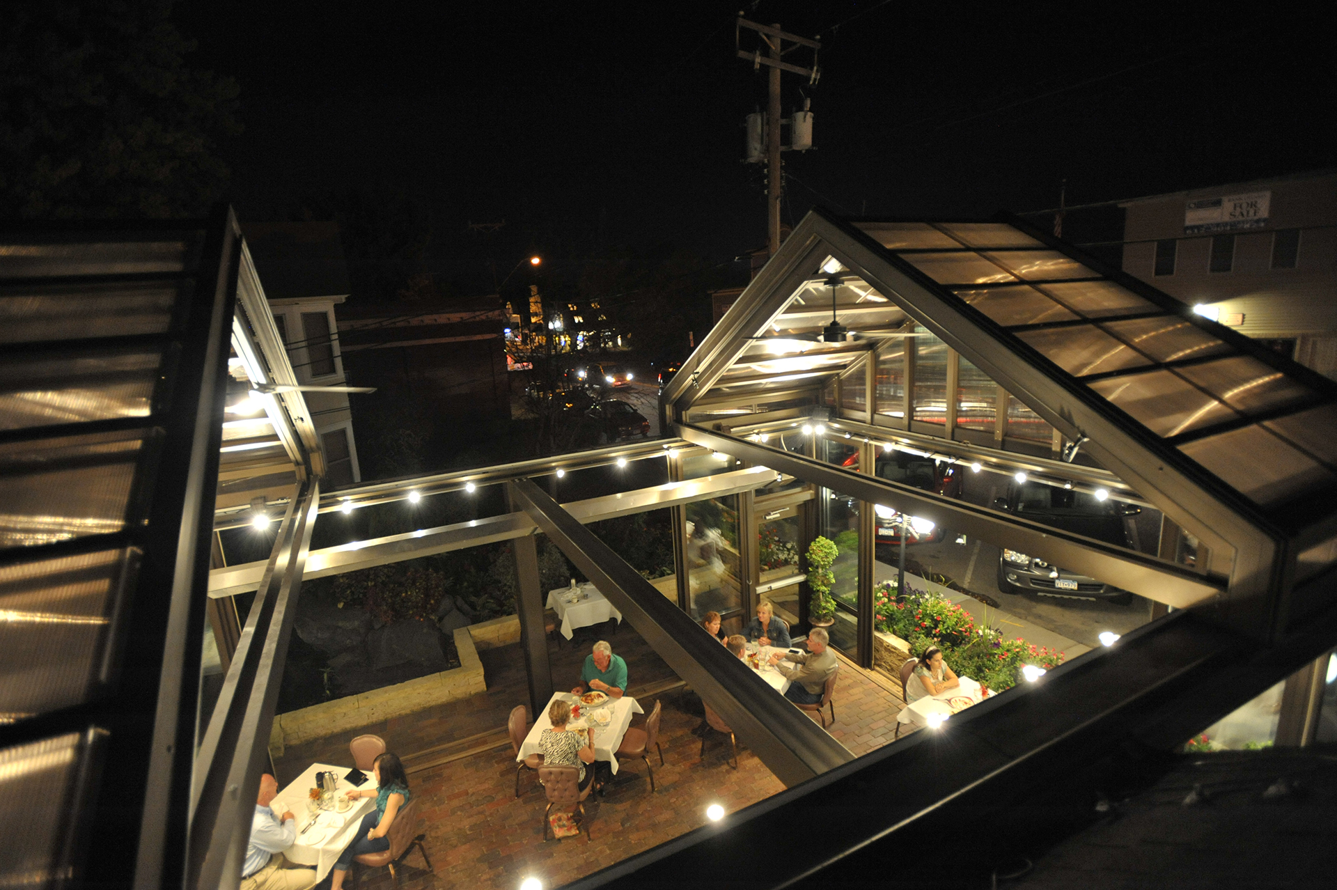 Arial view of retractable roof system on a restaurant patio