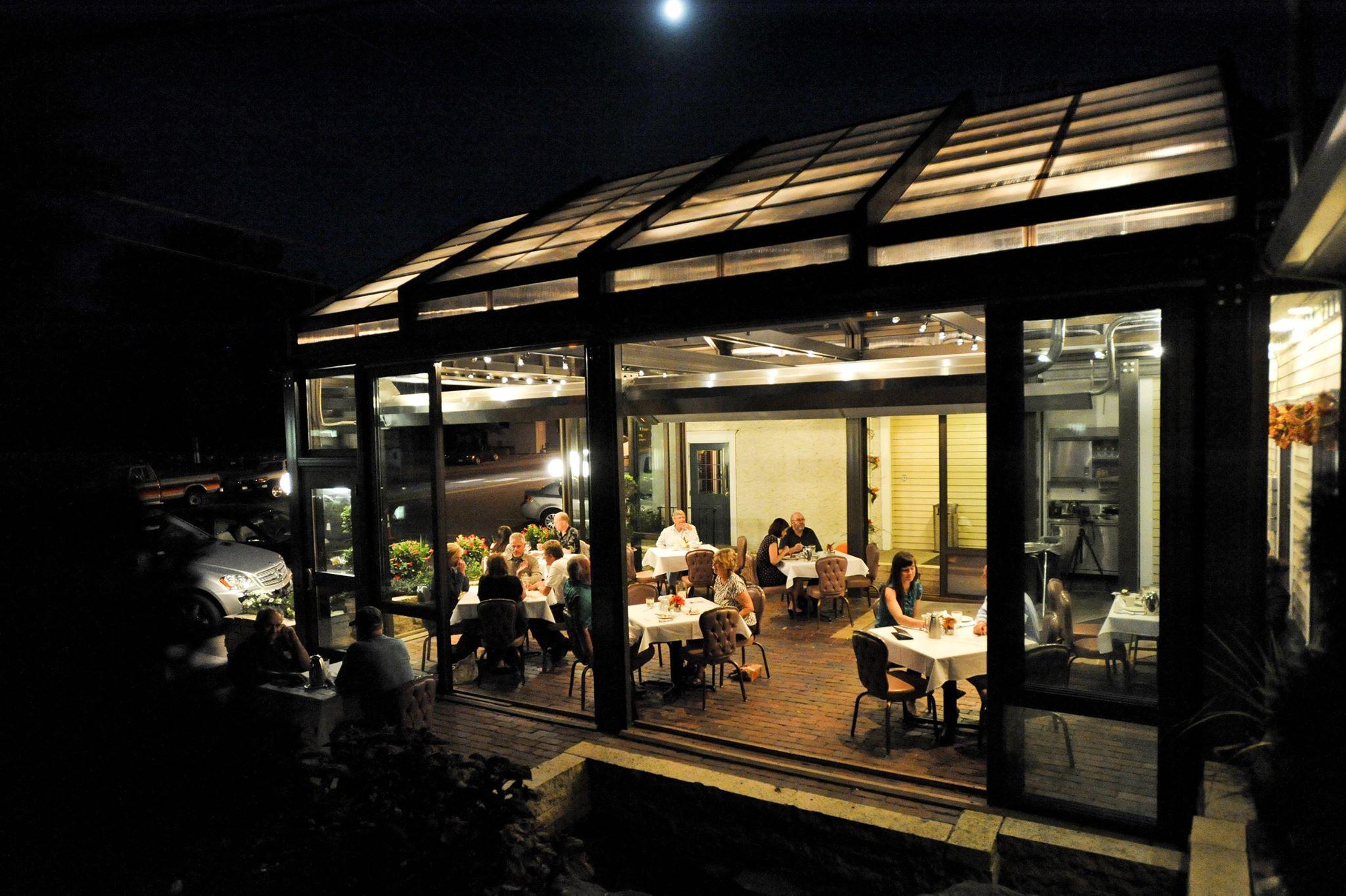 Patrons dining on restaurant patio at night