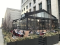 Restaurant patio structure with retractable roof