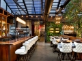 Upscale restaurant patio structure with retractable roof