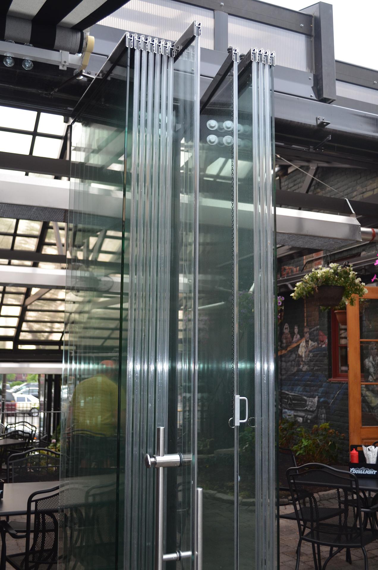 Frameless glass walls stack thin