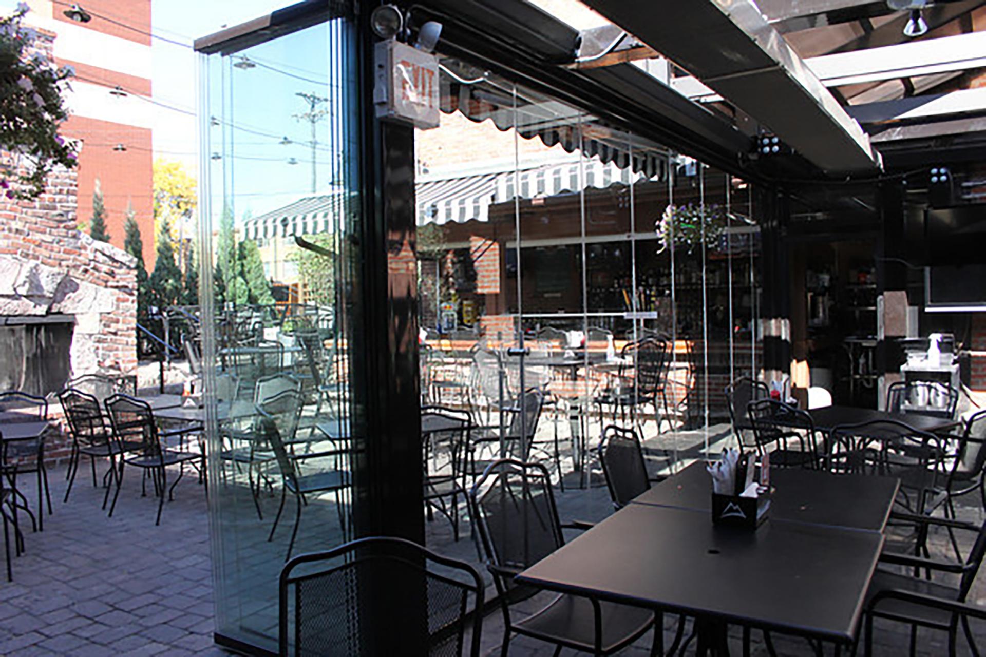 Opening frameless glass walls at restaurant